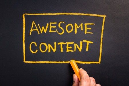 38689516 - hand writing  awesome content topic with chalk