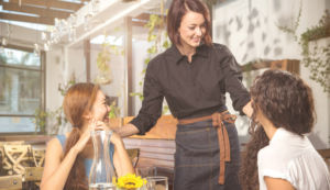 A business owner conversing with customers