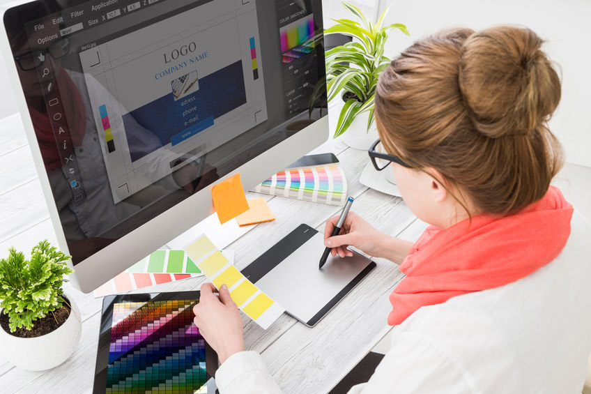 Designer working on a layout of a document
